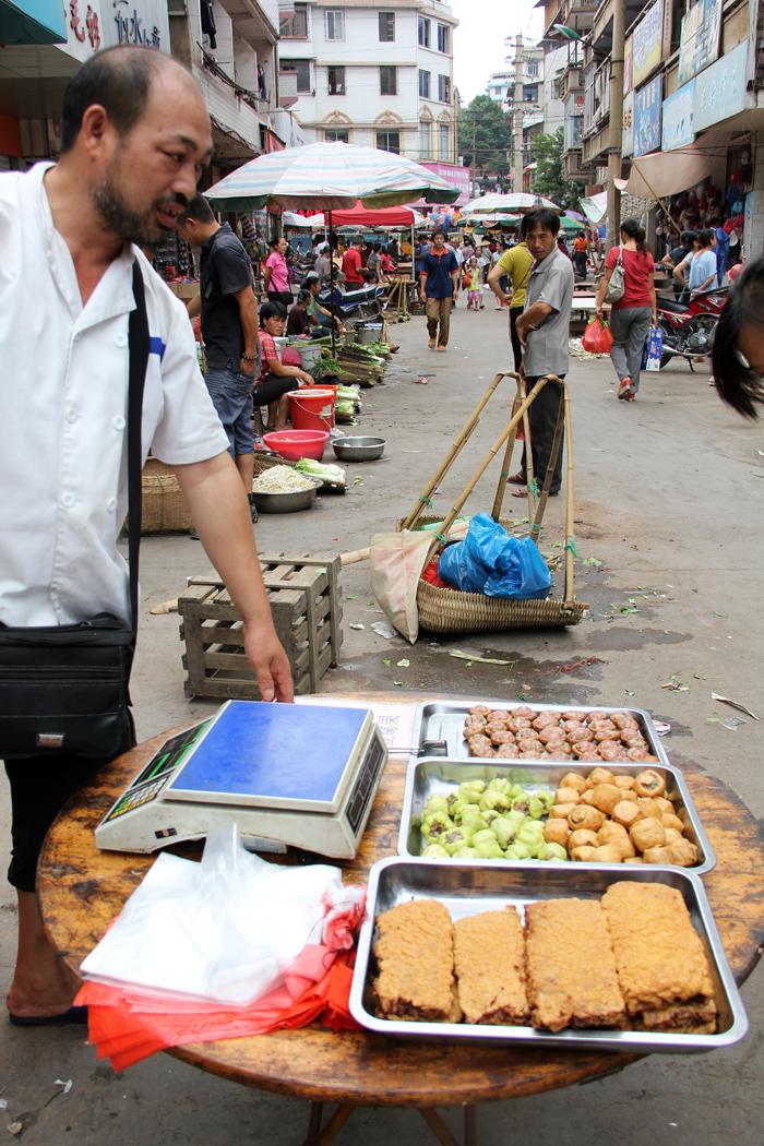 Market Seller in Sanjiang, China