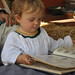 Sage reading the henna design book at Renaissance faire 9-18-11