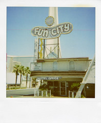 Fun City (Nick Leonard) Tags: old city vegas blue windows summer sky classic film pool sign analog vintage polaroid outdoors office doors lasvegas nevada nick entrance motel scan retro palmtrees signage thestrip vacancy expiredfilm lasvegasblvd polaroidcamera funcity colortv instantfilm 600film type600 epson4490 polaroid600film polaroidfilm funcitymotel northstrip integralfilm nickleonard expired2009 edgecut