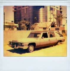 Cadillac Hearse (Nick Leonard) Tags: old city vegas windows summer hot classic film car analog vintage buildings polaroid outdoors death downtown doors desert lasvegas nevada nick cadillac scan retro tires funeral transportation heat vehicle polaroidspectra hearse artsdistrict instantfilm epson4490 spectrafilm colorshade integralfilm nickleonard theimpossibleproject polaroidonyx pz680 samplesalefilm