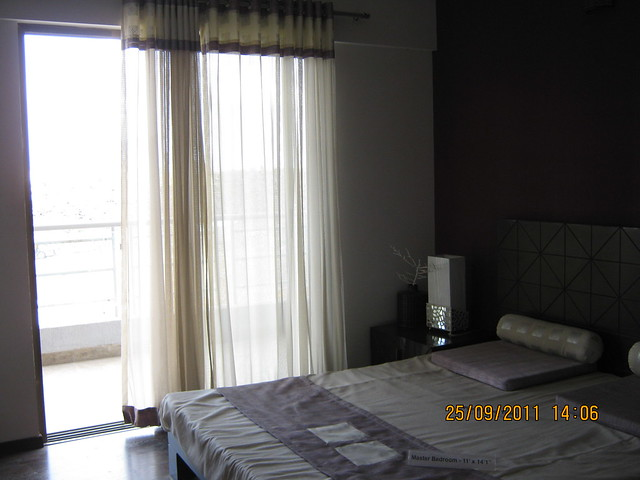 "Balcony & Master Bedroom (11'x14'1"") of a 3 BHK Sample Flat in Tower 1 at Paranjape Schemes' Blue Ridge, Hinjewadi Phase 1, Pune"