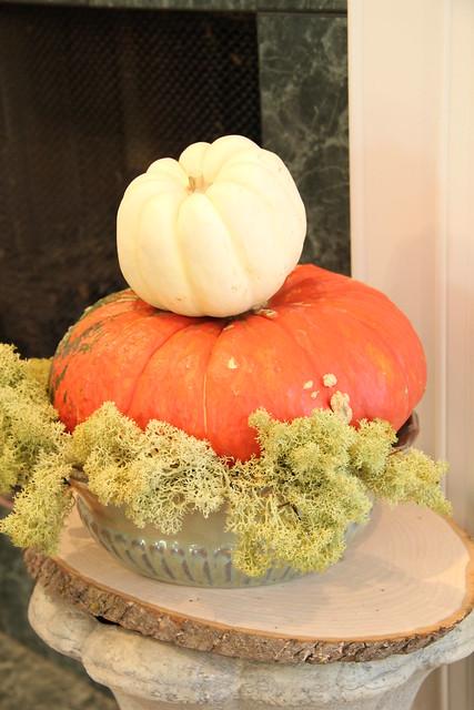 stacked pumpkins on urn