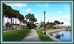 Sarah and Doris Take a Walk (Chris C. Crowley- catching up on editing- be back ) Tags: park trees friends people reflection grass buildings palms streetlight scenic sidewalk blueskies halifaxriver daytonabeachflorida chriscrowley celticsong22 walkingatthemarina halifaxharbormarina sarahanddoristakeawalk