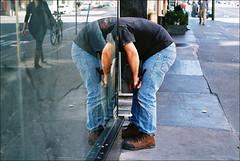 . (davies.thom) Tags: street man film public glass mirror ditch pavement candid streetphotography pedestrian jeans keep worker everyday nikonf3 decapitation prosaic keep2 keep3 keep4 keep5 keep6 ditch2 ditch3 ditch6 ditch8 ditch9 ditch4 ditch5 ditch7 ditched10 thomdavies