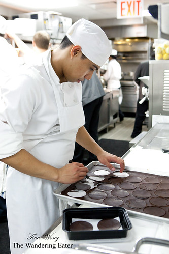 Cutting chocolate discs (taken in the kitchen)