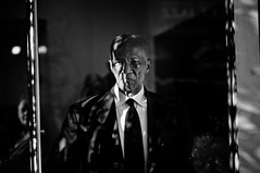 Behind Glass (Rinzi Ruiz [street zen]) Tags: life california street door light shadow urban blackandwhite bw usa man eye art glass monochrome photography photo losangeles flickr view bald picture streetphotography tie suit metropolis wrinkles littletokyo losangelesstreetphotography
