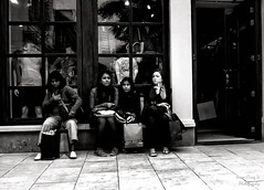shopping break (Le Xuan-Cung) Tags: summer people blackandwhite bw sun sunlight holland portraits reflections lightsandshadows nikon women waiting mood afternoon faces geometry citylife streetshots streetphotography atmosphere streetlife streetscene nb sw drama outlet roermond sunnyday limburg clothingstore polfilter nikond1h circularfilter lightsanddarks characterstudies livinginholland
