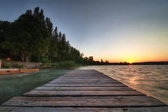 Dusk on the Pier (TheFella) Tags: longexposure blue sunset red sky sun lake slr texture yellow clouds digital photoshop canon eos golden pier photo wooden high europe hungary dynamic dusk budapest photograph processing slowshutter dslr range plank planks balaton hdr highdynamicrange veszprm magyarorszg tihany plattensee postprocessing 500d photomatix lakebalaton transdanubia balcsi republicofhungary thefella conormacneill thefellaphotography