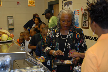 Food and Nutrition Service Administrator Audrey Rowe leads Sherwood Acres Elementary Magnet School students through the breakfast line at their Back to School Breakfast with SWAG (Students With Academic Greatness) Event on August 16, 2011, in Albany, Ga.