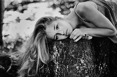 (laura zalenga) Tags: bw nature girl beautiful face forest hair hands pretty dress bokeh sister calm stump shoulder laurazalenga