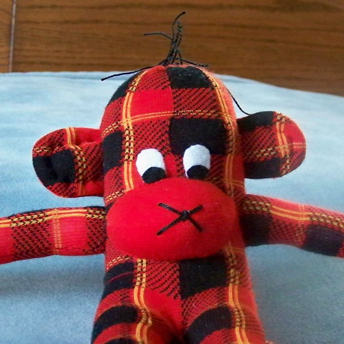 Red, black and gold plaid sock monkey