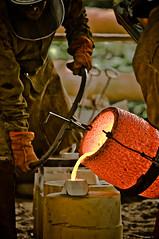 molten bronze (f.larkin) Tags: hot industry bronze fire iron artist industrial glow steel weld flame smokestacks heat melt grime furnace sparks ladel relic molten ironore sloss blastfurnace slossfurnaces metalarts f64g37champ