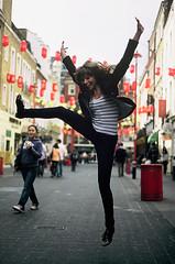 Jana in Soho (aermiks) Tags: street england london girl jump pavement soho pedestrian fujifilm fujichrome provia nikonf4 girljumping lanterens