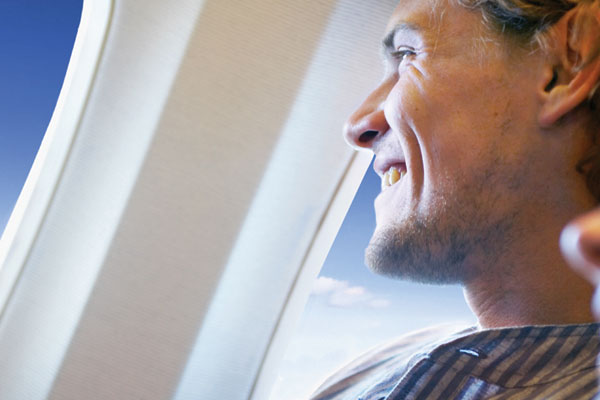 Guy looking out of Airplane window