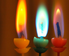 Three Colours (Tony Worrall) Tags: light party copyright 3 color beauty fun fire three nice rainbow candles glow candle colours image stock row flame heat glowing inside tall trio lit dim wick shimmer firey funparty ©2011tonyworrall