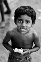 The missing piece-II (A. adnan) Tags: poverty street portrait blackandwhite smile children nikon bangladesh gec chittagong nikkor50mmf14d bangladeshiphotographer d7000 peopleofbangladesh aadnan613 geccircle gettyimagesbangladeshq3 geccirclechittagong gecmoore
