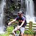 Sathya posing at a waterfall