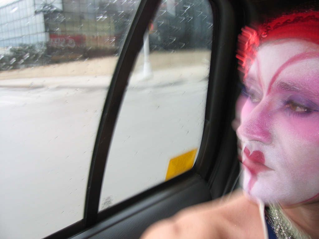 Whiteface Clown riding in New York City taxi cab