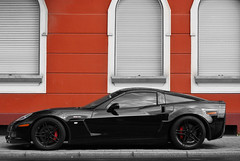 The Black Beast (Raoul Automotive Photography) Tags: auto road red bw orange black chevrolet wet car rain wheel monster america germany star power sony tripod wheels wide band filter german american beast editing mm 1855 alpha bb dslr dusseldorf 50 rim rims dsseldorf corvette v8 hama dt circular slt edit c6 61 pl z06 55200 kenko a230 polarisation zo6 a230l