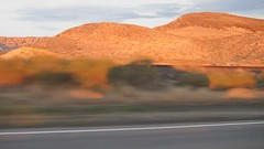 Shadow play enroute to Moab, Utah  (Quicktime clip) (rwchicago) Tags: sunset movie landscape utah video highway clip moab lightandshadow quicktime time:hour=6pm