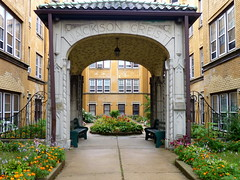 Jackson Crest (yooperann) Tags: chicago brick yellow gate apartments arch courtyard forestpark chicagoist