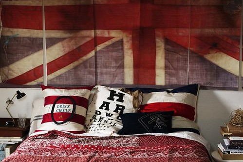 Chris Court {eclectic vintage modern bedroom using flags as art} by recent settlers