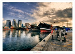 Khor Dubai II (Damon | Photography) Tags: old city sunset sea sky cloud sun seascape reflection set clouds port ancient nikon dubai ship ships uae shift sigma shore mm scape 1020 hdr tiltshift sigma1020mm d90 khor photomatix nikond90