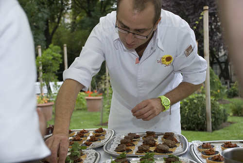 Chef Lionel Levy putting the final touch on his mini hamburgers with Pistou (cold sauce made from cloves of garlic, fresh basil from the garden, and olive oil) and Tapenade (puréed olives, capers, anchovies and olive oil)