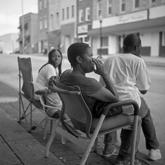 (patrickjoust) Tags: street city people urban bw usa white black west 120 6x6 tlr blancoynegro film home festival analog america square lens person us reflex md focus waiting sitting fuji mechanical chairs pennsylvania cigarette united watching north patrick twin maryland super baltimore cadillac parade 150 sidewalk v homecoming epson fujifilm medium format neopan 100 states manual 500 rodinal avenue 80 joust developed develop acros estados 80mm f35 blancetnoir unidos ricohflex v500 schwarzundweiss autaut patrickjoust