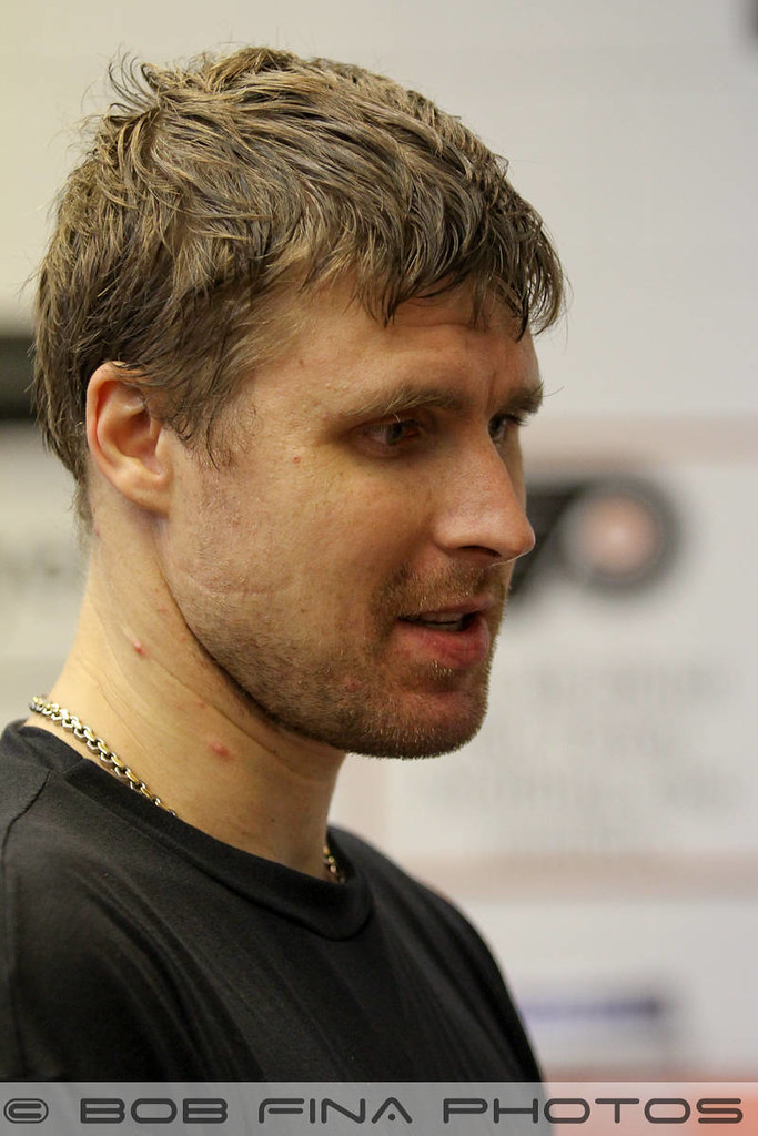 Ilya Bryzgalov #30 of the Philadelphia Flyers speaking with the Flyer's Russian translator