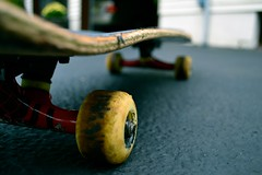 The wheels that were once soft and the board that was once smooth meets asphalt for a cruise (Sean Brunner) Tags: street wood bokeh pavement board wheels deck skateboard spitfire trucks asphalt thunder rolling thrashed griptape