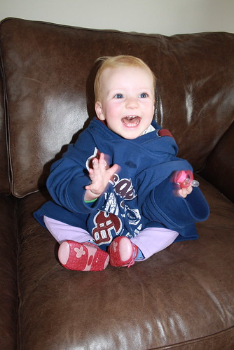 Happy in Daddy's jumper by Little Bambini