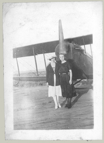 Two women and a biplane