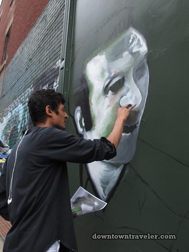REUBEN PETER FINLEY creating street art mural in Montreal