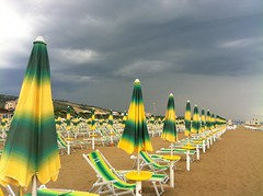 stormy beach (SS) Tags: light sea brazil sky italy storm green beach yellow clouds composition landscape photography grey vanishingpoint sand colorful angle pov empty hill perspective favorites front diagonal explore parasol page depth comments abruzzo iphone costaadriatica