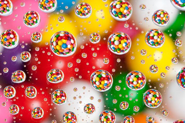 Gumballs under water drops