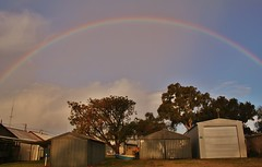 Rainbow over Fishermans Bay (robynbrody) Tags: rain rainbow yorkepeninsular spencergulf southaustralia sky shantytown shanty shacks portbroughton light geotagged fishermanshuts fishermansbay clouds buildings building australia