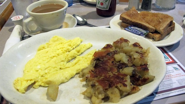 Scrambled eggs, home fries, wheat toast, and coffee