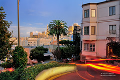 Sunset on Lombard Street - San Francisco, California (Darvin Atkeson) Tags: world sanfrancisco road street desktop city bridge light sunset wallpaper tower skyline night painting bay long exposure cityscape suspension background famous landmark winding transamerica lombard darvin crookedest atkeson darv liquidmoonlightcom