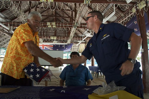 A Tokelau elder shaking hands with a USCG crewman.