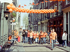 Before the Queen's party (JaZ99wro) Tags: street orange amsterdam baloon portra mamiya645 kodakportra160vc2 160vc2 rolleidigibasec41kit negfix8