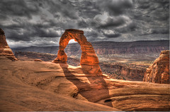 Delicate Arch (BHagen) Tags: park cloud west nature clouds outdoors utah nikon arch desert wind cloudy hiking arches climbing national western moab archesnationalpark hdr delicatearch d90 erotion