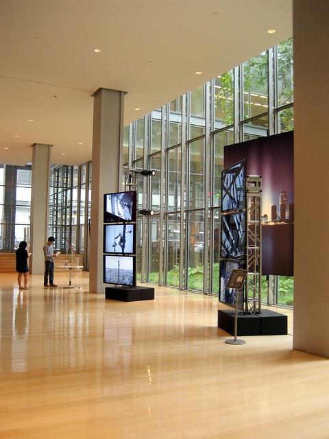 Three exhibits near the building's center atrium