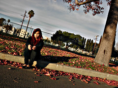 Alone in Manchester Square (TheJudge310) Tags: california autumn woman abandoned girl leaves pretty candy autumnleaves redhead inglewood beautifulgirl neighboorhood inglewoodcalifornia manchestersquare abandonedneighboorhood