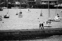 Lower Granton Harbor (ChrisJohnston82) Tags: sea people blackandwhite bw water canon walking boats scotland edinburgh sailing harbour sailboats canoneos 400d canoneos400d tidebreak canon400d grantor