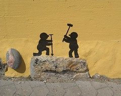 Small men in Marstal - 1 (Jaedde & Sis) Tags: yellow wall stones painted silhouette men art 15challengeswinner challengefactorywinner thechallengefactory sweep bigmomma friendlychallenges