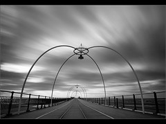 Pier pressure 2............ (Chrisconphoto) Tags: longexposure bw clouds pier movement mood shapes le southport phew oneshot weldingglass 3minutes madeit