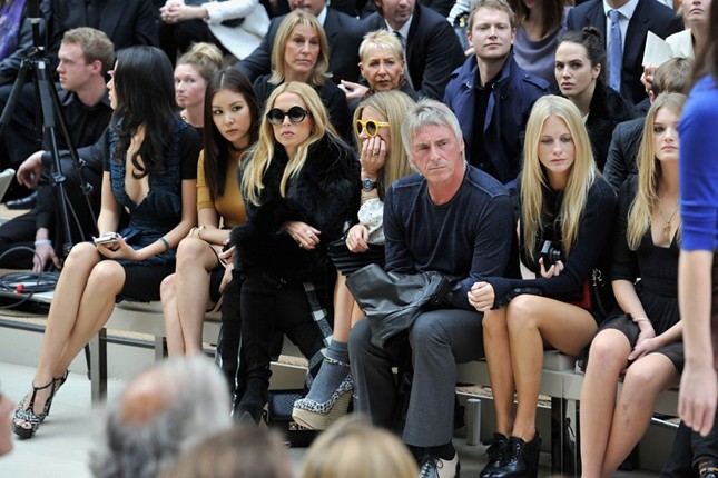 front row 4 - Go So Young, Rachel Zoe, Laura Bailey, Paul Weller, Poppy Delevingne and Lily Donaldson at the Burberry Prorsum Spring Summer 2012