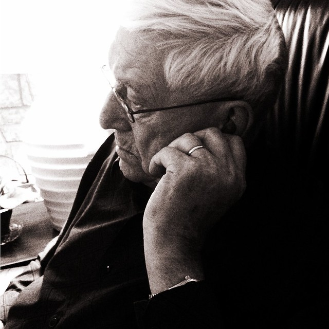 my grandfather adjusting his whistling hearing aid