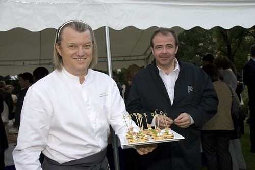 Chefs Philippe Bohrer and Eric Salmon presenting U.S. style mini pancakes with bacon and Persil (from the garden)